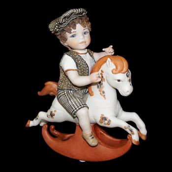 """Кукла """"Мальчик сидящий на лошадке-качалке"""""""