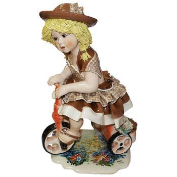 """Статуэтка """"Кукла на велосипеде в светло-коричневом платье"""""""
