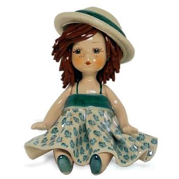 """Статуэтка """"Кукла сидящая с темными волосами в зеленом платье"""""""