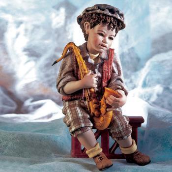 """Кукла """"Мальчик играющий на саксофоне"""""""